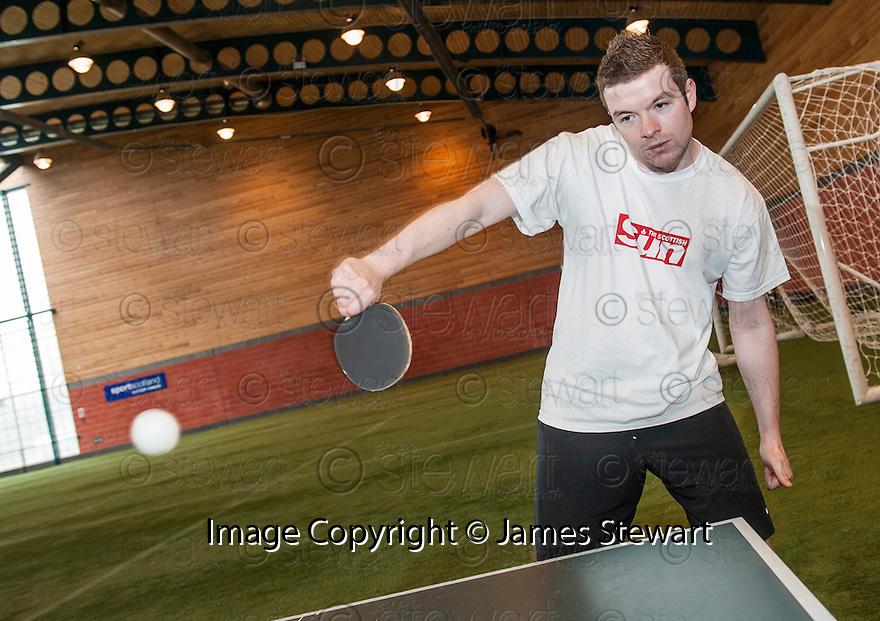 Sun Sport reporter Kenny Millar is comprehensively beaten in a Table Tennis Challenge Match by Rangers' Junior Ogen .
