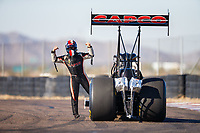 Jan 31, 2018; Chandler, AZ, USA; NHRA top fuel driver Steve Torrence flexes during Nitro Spring Training Testing at Wild Horse Pass Motorsports Park. Mandatory Credit: Mark J. Rebilas-USA TODAY Sports