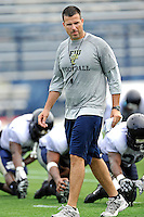 7 August 2011:  FIU Head Coach Mario Cristobal watches his players stretch the first day of fall practice with full pads at University Park Stadium in Miami, Florida.