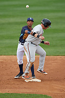Wilmington Blue Rocks second baseman Jecksson Flores (4) throws to first base as Alex Murphy (36) pops up after sliding in during the second game of a doubleheader against the Frederick Keys on May 14, 2017 at Daniel S. Frawley Stadium in Wilmington, Delaware.  Wilmington defeated Frederick 3-1.  (Mike Janes/Four Seam Images)