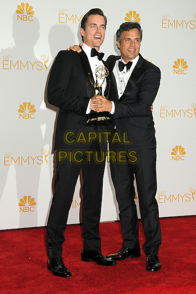 25 August 2014 - Los Angeles, California - Matt Bomer, Mark Ruffalo. 66th Annual Primetime Emmy Awards - Press Room held at Nokia Theatre LA Live. <br /> CAP/ADM/BGP<br /> &copy;BGP/ADM/Capital Pictures