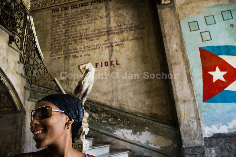 A young Cuban girl, wearing trendy sunglasses, stands in front of the ruined stairs inside a devastated house in the Old Havana, Cuba, 11 August 2008. About 50 years after the national rebellion, led by Fidel Castro, and adopting the communist ideology shortly after the victory, the Caribbean island of Cuba is the only country in Americas having the communist political system. Although the Cuban state-controlled economy has never been developed enough to allow Cubans living in social conditions similar to the US or to Europe, mostly middle-age and older Cubans still support the Castro Brothers' regime and the idea of the Cuban Revolution. Since the 1990s Cuba struggles with chronic economic crisis and mainly young Cubans call for the economic changes.