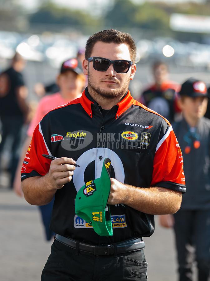 Nov 11, 2018; Pomona, CA, USA; Crew member for NHRA top fuel driver Leah Pritchett during the Auto Club Finals at Auto Club Raceway. Mandatory Credit: Mark J. Rebilas-USA TODAY Sports