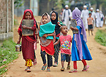 Children walk to a school in the Chakmarkul Refugee Camp near Cox's Bazar, Bangladesh. More than 600,000 Rohingya refugees have fled government-sanctioned violence in Myanmar for safety in this and other camps in Bangladesh.