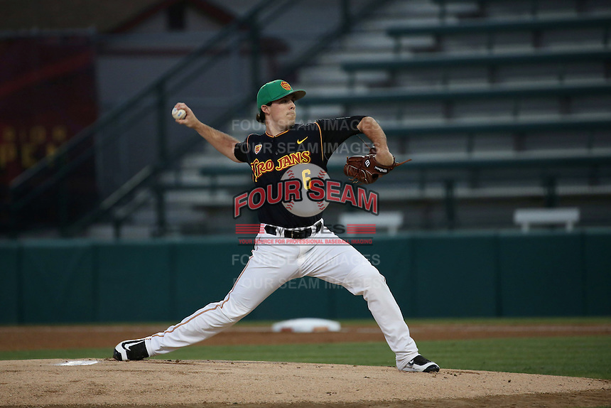 Kyle Davis (6) of the Southern California Trojans pitches against the California Bears at Dedeaux Field on March 18, 2016 in Los Angeles, California. California defeated Southern California, 5-4. (Larry Goren/Four Seam Images)