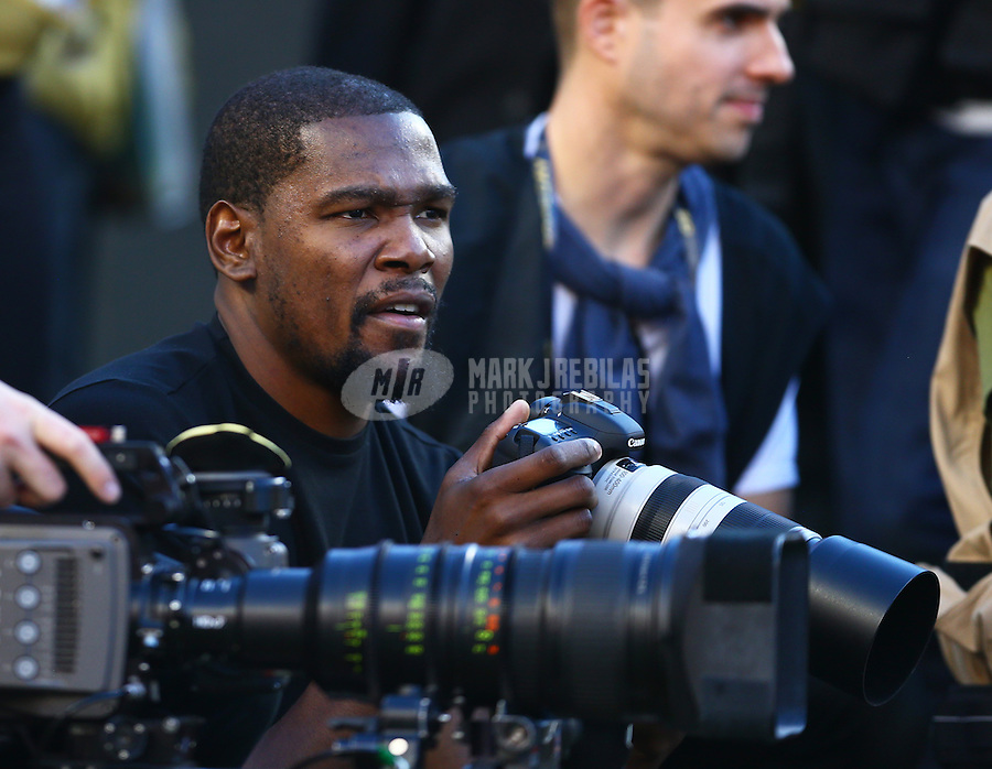 Feb 7, 2016; Santa Clara, CA, USA; Oklahoma City Thunder player Kevin Durant holds a canon camera as he works as a sideline photographer during the Denver Broncos against the Carolina Panthers in Super Bowl 50 at Levi's Stadium. Mandatory Credit: Mark J. Rebilas-USA TODAY Sports
