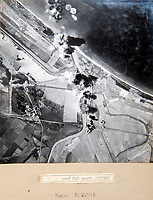 BNPS.co.uk (01202 558833)<br /> Pic: PhilYeomans/BNPS<br /> <br /> Bombing raid near Albinia north of Rome.<br /> <br /> Unearthed - fascinating unseen archive of cameras, photographs, documents and medals from a British aerial reconnaisance expert who fought all the way through Africa and southern Europe in WW2.<br /> <br /> Flt Lt Eric Cooper from London kept all his wartime paraphernalia, including his K20 handheld camera and stereoscopic plotting instruments until his death in Devon aged 96 in 2012.<br /> <br /> The incredible photographs show bombing raids, amphibious landings and badly damaged aircraft alongside off duty snaps of the campaign throughout the mediterraenean.<br /> <br /> His nephew is now selling the compelling collection at Plymouth Auction Rooms in Devon next week.
