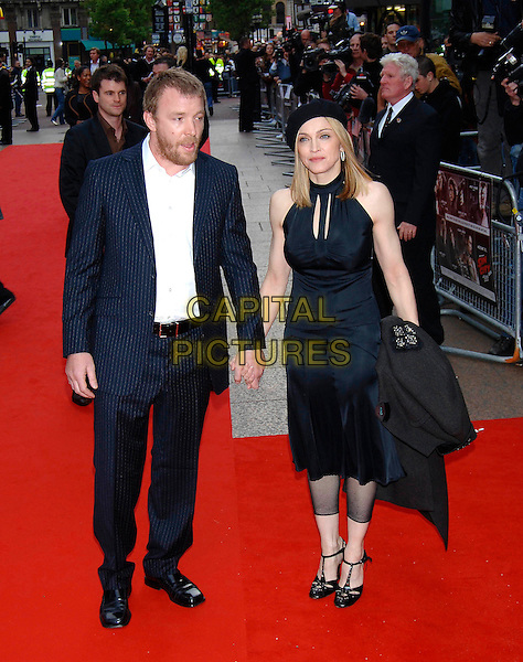 """GUY RICHIE & MADONNA.Red Carpet Arrivals at the UK Film Premiere of """"Sin City"""", Empire Cinema Leicester Square, .London, May 23rd 2005..full length black beret hat married husband wife dress halterneck cut out tights cut off leggings holding hands t bar shoes t-bar.Ref: PL.www.capitalpictures.com.sales@capitalpictures.com.©Capital Pictures"""
