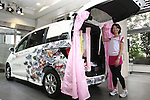 July 8, 2010 - Tokyo, Japan - A model displays the new compact multi-wagon Honda Freed Spike during a press preview at the company's headquarters in Tokyo, Japan, on July 8, 2010. The Freed Spike features a compact body size for nimble maneuvring, as spacious high-utility cabin and a cargo area made for an extensive range of uses. Honda said it is aiming to sell 2,500 units per month with starting price of 1,598 million yen (18,300 $US).