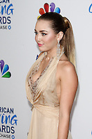 LOS ANGELES - DEC 9:  Miley Cyrus arrives at the 2011 American Giving Awards at Dorothy Chandler Pavilion on December 9, 2011 in Los Angeles, CA