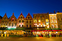 Belgium night photo of colorful cafes in Marketplace in downtown Bruges Belgium