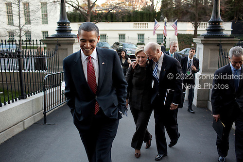 Washington, DC - December 1, 2009 -- United States President Barack Obama, Vice President Joe Biden, Secretary of State Hillary Rodham Clinton, and Chief of Staff Rahm Emanuel, walk from the West Wing to the Eisenhower Executive Office Building (EEOB), Tuesday, December 1, 2009. .Mandatory Credit: Pete Souza - White House via CNP