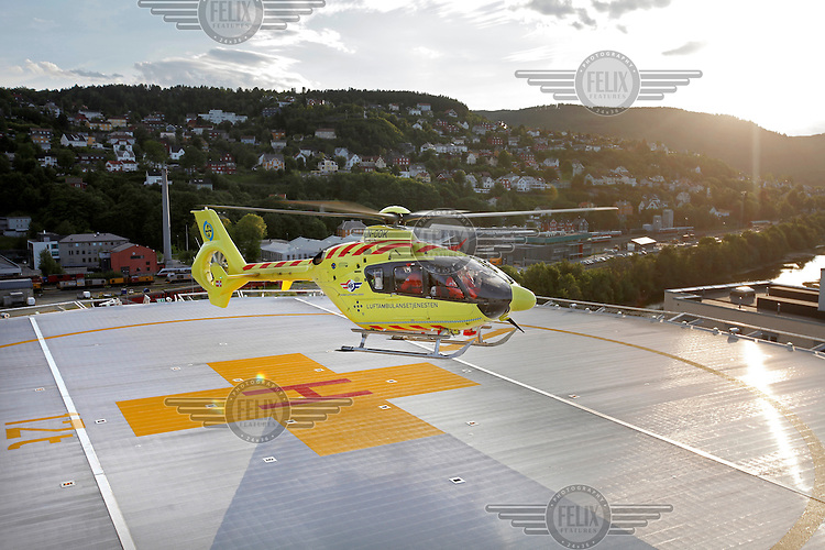Helicopter arrive at the helipad at St.Olav hospital in Trondheim. Norwegian Air Ambulance operating EC 135 helicopter out of their base in Trondheim, one of eight bases operated by the company.