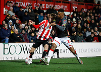 4th January 2020; Griffin Park, London, England; English FA Cup Football, Brentford FC versus Stoke City; Tyrese Campbell of Stoke City challenges Mads Roerslev of Brentford - Strictly Editorial Use Only. No use with unauthorized audio, video, data, fixture lists, club/league logos or 'live' services. Online in-match use limited to 120 images, no video emulation. No use in betting, games or single club/league/player publications