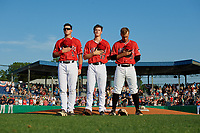 Batavia Muckdogs Nic Ready (5), Jackson Rose (37), and Andrew Turner (9) during the national anthem before a NY-Penn League game against the State College Spikes on July 3, 2019 at Dwyer Stadium in Batavia, New York.  State College defeated Batavia 6-4.  (Mike Janes/Four Seam Images)