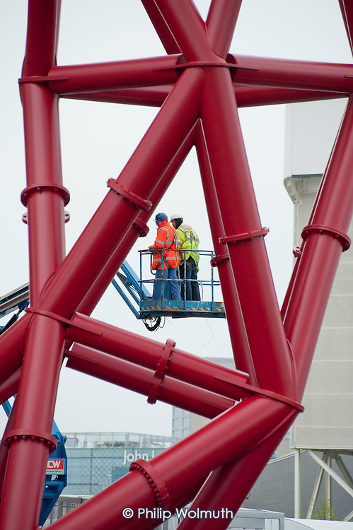 Construction workers on the ArcelorMittal Orbit, designed by Anish Kapoor, in the London 2012 Olympic Park, Stratford.