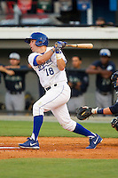 Andrew Ayers (18) of the Burlington Royals follows through on his swing against the Pulaski Mariners at Burlington Athletic Park on June20 2013 in Burlington, North Carolina.  The Royals defeated the Mariners 2-1 in 13 innings.  (Brian Westerholt/Four Seam Images)