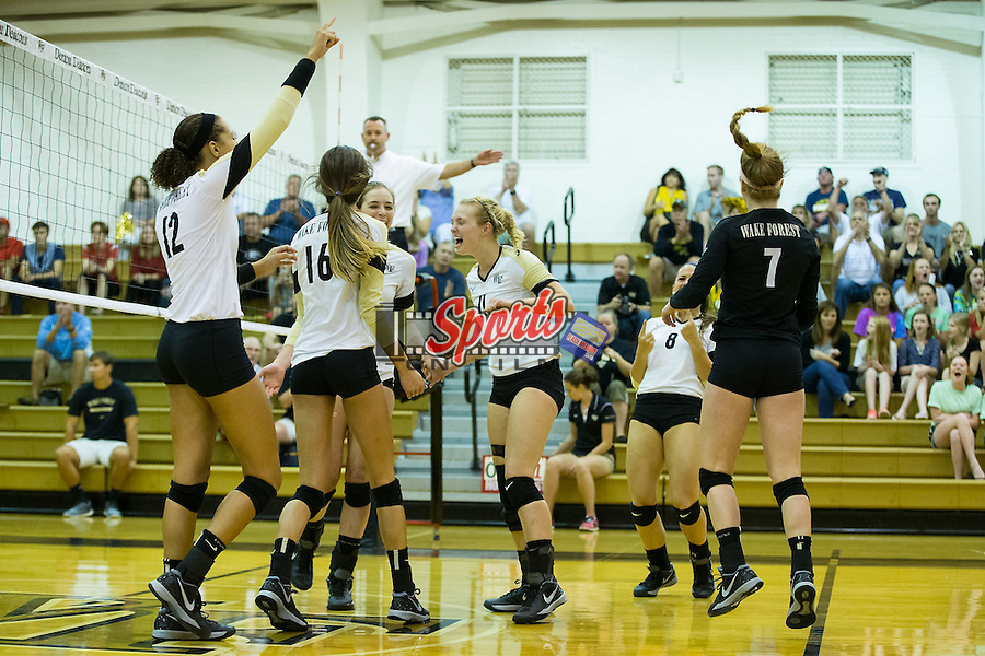 Rachel Burau (center) celebrates with teammates after they scored a point against the Georgia Bulldogs in Reynolds Gymnasium on September 18, 2015 in Winston-Salem, North Carolina.  The Demon Deacons defeated the Bulldogs 3-1.   (Brian Westerholt/Sports On Film)