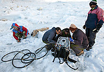 Dr Shresth Tayal (second from right), Glaciologist at The Energy and Resources Institute (TERI) supervises his team (from left)  Phurbu Tsering Butia, Nathaniel Dkhar, Mohammad Ashraf Genai and Sanjay Balmiki attempt to light a butane burner - part of the equipment used on the fast reducing Rathong Glacier  below the 6678 meter Rathong Peak  in the North East Indian state of Sikkim close to the Nepalese border. Considered to be a themometre of the environment, it has been chosen by TERI to be a test case of environmental damage being done in India and China. Dr. Tayal is conducting three dimensional tests that include measuring the depth of the ice to form concrete conclusions on the fate of the glacier.The Indian Government is denying the glaciers' demise despite data suggesting it has been reduced by more than over 80% in the last 42 years.