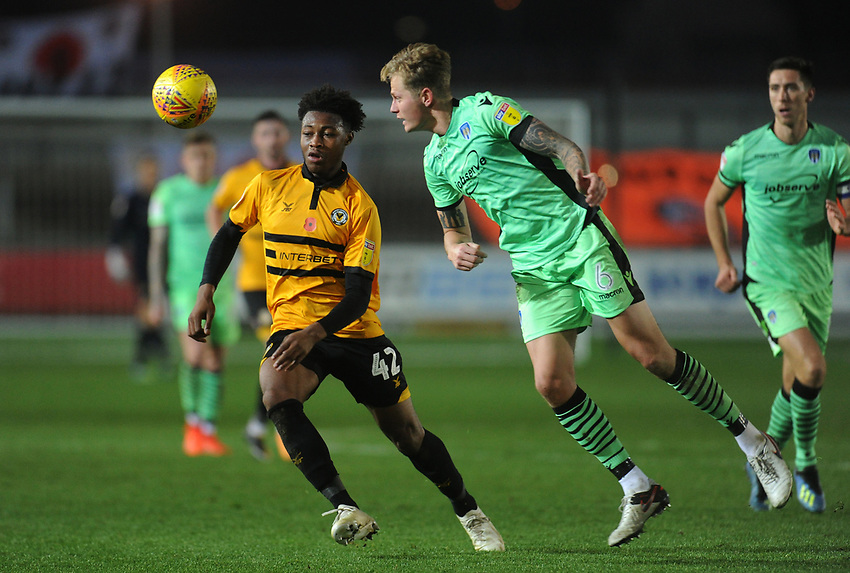 Newport County's Antoine Semenyo vies for possession with Colchester United's Frankie Kent<br /> <br /> Photographer Kevin Barnes/CameraSport<br /> <br /> The EFL Sky Bet League Two - Newport County v Colchester United - Saturday 17th November 2018 - Rodney Parade - Newport<br /> <br /> World Copyright © 2018 CameraSport. All rights reserved. 43 Linden Ave. Countesthorpe. Leicester. England. LE8 5PG - Tel: +44 (0) 116 277 4147 - admin@camerasport.com - www.camerasport.com