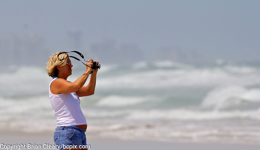 A woman photographs heavy surf generated by Hurricane Irene, Ponce Inlet, FL, Thursday, August 25, 2011.   (Photo by Brian Cleary/www.bcpix.com)
