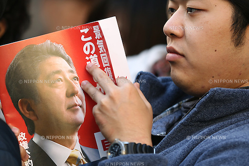 A man reads a manifesto of Japan's ruling Liberal Democratic Party (LDP) before an arrival of LDP lawmaker Shinjiro Koizumi's to deliver a speech to support  a candidate in Kawasaki city, Japan, on Saturday, December 13, 2014.  (Photo by Yuriko Nakao/AFLO)