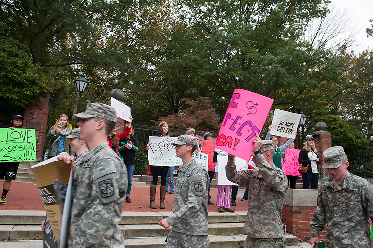Women cheer on the men participating in the Walk a Mile in Her Shoes event. Photo by Elizabeth Held