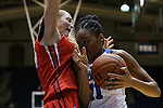 17 December 2015: Duke's Azura Stevens (right) charges into Liberty's Ashley Rininger (left). The Duke University Blue Devils hosted the Liberty University Flames at Cameron Indoor Stadium in Durham, North Carolina in a 2015-16 NCAA Division I Women's Basketball game. Duke won the game 79-41.