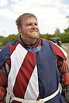 Garden City, New York, U.S. - June 14, 2014 - ANDREW DIONNE, of Bowie MD, is a USA Knights member about to put on warrior combat sport armor, at Eternal Con, the annual Pop Culture Expo, with costumes, Comic Books, Collectibles, Gaming, Sci-Fi, Cosplay, Horror, and held at the Cradle of Aviation Museum on Long Island. Armored Combat League members compete in international medieval combat competitions.