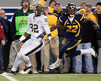 WVU defensive back Brandon Hogan (22) defends Pitt wide receiver Jonathan Baldwin (82). The West Virginia Mountaineers defeated the Pittsburgh  Panthers 19-16 on November 27, 2009 at Mountaineer Field at Milan Puskar Stadium, Morgantown, West Virginia.
