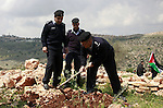 Palestinian security officers plant trees during an event marking Land Day ,in the village of  Kufr Diek , West Bank, Thursday , March 29, 2011. Land Day commemorates the killing of six Arab citizens of Israel by the Israelis on March 30, 1976 during protests over confiscations of Arab land.  Photo by Wagdi Eshtayah