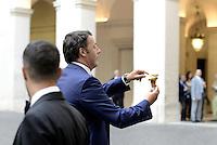 Roma, 29 Agosto, 2014<br />  Matteo Renzi offre il gelato nel cortile di Palazzo Chigi al termine del consiglio dei Ministri in risposta alla copertina di The Economist.<br /> Renzi con  il gelato a Palazzo Chigi.<br /> The Italian Premier  Matteo Renzi  with ice cream in the courtyard of the Palazzo Chigi after the Council of Ministers in response to the cover of The Economist.