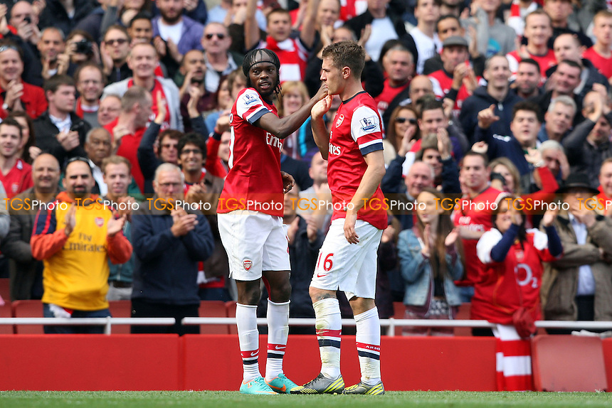 Gervinho of Arsenal is congratulated by Aaron Ramsey after scoring Arsenal's goal - Arsenal vs Chelsea - Barclays Premier League at the Emirates Stadium, Arsenal 29/09/12 - MANDATORY CREDIT: Rob Newell/TGSPHOTO - Self billing applies where appropriate - 0845 094 6026 - contact@tgsphoto.co.uk - NO UNPAID USE.