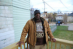 Marvin Reeves, 56, stands on the back porch of the house he bought for his daughter in the Greater Grand Crossing neighborhood in Chicago, Illinois on November 29, 2015.  Reeves purchased and renovated the house with money he received in settlement from the City of Chicago after a codefendant, Ronald Kitchen, and he were both tortured and Kitchen confessed to a crime both were innocent of; Reeves spent 21 years incarcerated from 1988-2009 for a South Side arson that killed two women and three children and had received five consecutive life sentences.