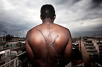 Greece/Athens/ Nov. 23.2012. Hasan 33 years old refugee from Sudan, saw his worst day in his life as he said in the centre of Athens. He was beaten by a group of ten men and stabbed with a knife on his back making the symbols of Golden Dawn. Racially motivated, brutal attacks and hate crimes have become an almost daily phenomenon in Greece that goes over its fifth year of recession..Giorgos Moutafis