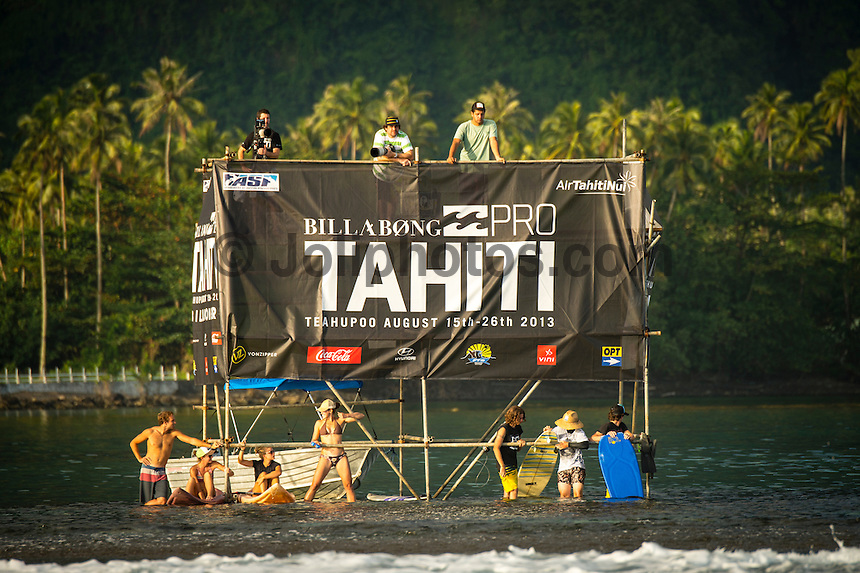 TEAHUPO'O, Taiarapu/Tahiti (Thursday, August 15, 2013): Contest organisers at the 6th stop on the 2013 ASP (Association of Surfing Professionals) Men&rsquo;s World Championship Tour decided to get the Billabong Pro Tahiti off and running on the first day of the official waiting period. With light winds and a south west swell in the 3'-5' range the contest kicked off at 7.30 am this morning with all of Round One completed and four heats of Round Two. Highlights of the day included the contests first perfect 10 point ride awarded to contest wildcard Anthony Walsh (AUS), Kelly Slater (USA) snatching a win on his last wave of the heat, Air Tahiti Nui Trials winner Alain Riou (PYF) elimination one of the top seeds Adriano de Souza (BRA) and defending champion Mick Fanning (AUS) surviving a second round heat.<br />  Photo: joliphotos.com