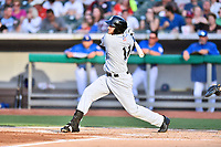 Biloxi Shuckers first baseman Dustin DeMuth (11) swings at a pitch during a game against the Tennessee Smokies at Smokies Stadium on May 26, 2017 in Kodak, Tennessee. The Smokies defeated the Shuckers 3-2. (Tony Farlow/Four Seam Images)
