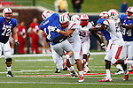 Rutgers Scarlet Knights linebacker Kevin Snyder (45) hits Southern Methodist Mustangs quarterback Garrett Gilbert (11) in action during the game between the Rutgers Scarlet Knights and the SMU Mustangs at the Gerald J. Ford Stadium in Dallas, Texas.  Rutgers leads SMU 21 to 7 at halftime.