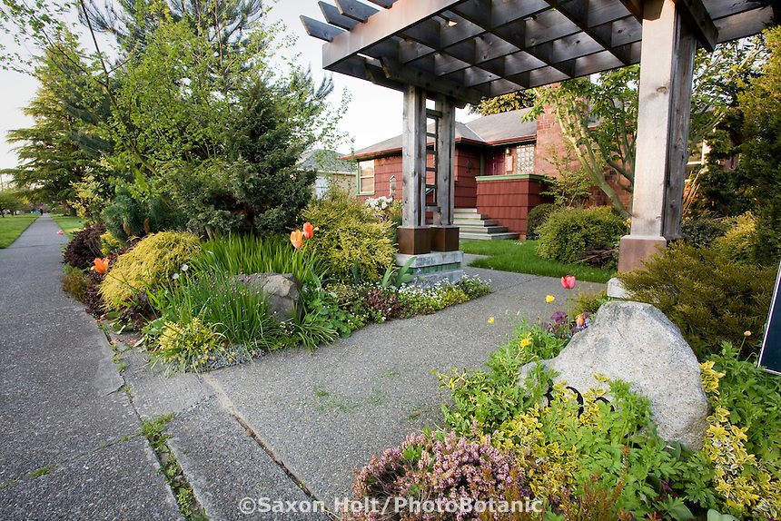 Front sidewalk entry garden edged with mixed border with pergola, arbor into small space Seattle front yard;  Jennifer Carlson garden