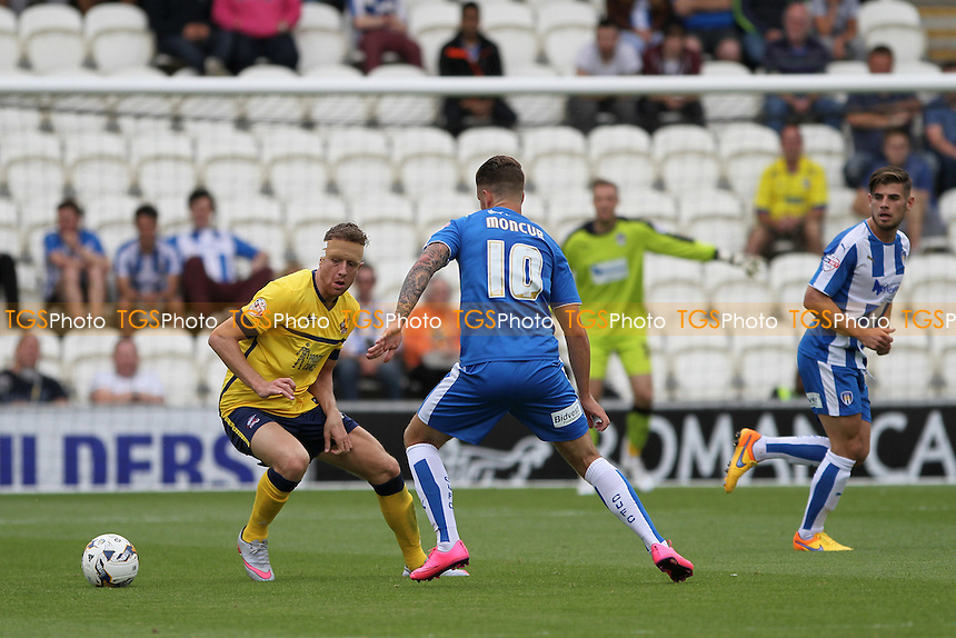 Kevin van Veen of Scunthorpe United takes on George Moncur of Colchester United during Colchester United vs Scunthorpe United, Sky Bet League 1 Football at the Weston Homes Community Stadium, Colchester, England on 29/08/2015