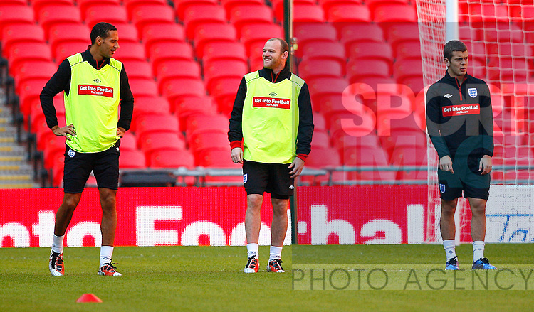 Rio Ferdinand, Wayne Rooney, and Jack Wilshere of England during a training session at Wembley Stadium