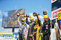 Sep 3, 2018; Clermont, IN, USA; (From left) NHRA pro stock motorcycle rider L.E. Tonglet , pro stock driver Tanner Gray , funny car driver J.R. Todd and top fuel driver Terry McMillen celebrate after winning the US Nationals at Lucas Oil Raceway. Mandatory Credit: Mark J. Rebilas-USA TODAY Sports