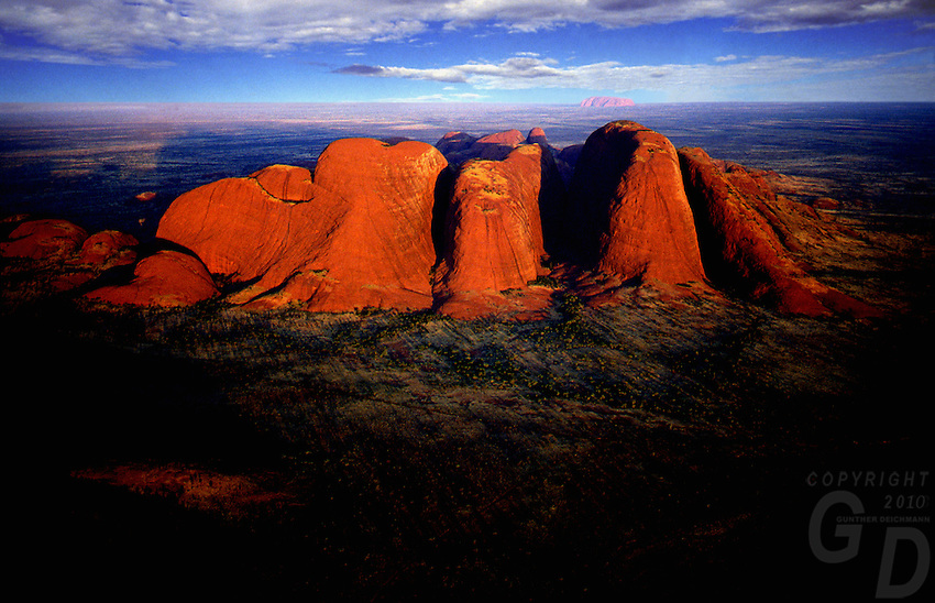 Images from the Book Journey Through Colour and Time - Aerial over the Olgas in the background Ayers Rock