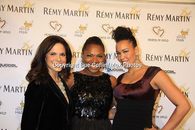 "CNN's Soledad O'Brien (co-mistress of ceremonies) with Deborah Koenigsberger and Maya Azucena at Hearts of Gold's 16th Annual Fall Fundraising Gala & Fashion Show ""Come to the Cabaret"", a benefit gala for Hearts of Gold on November 16, 2012 at the Metropolitan Pavilion, New York City, New York.   (Photo by Sue Coflin/Max Photos)"