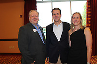 NWA Democrat-Gazette/CARIN SCHOPPMEYER Greg Chandler (from left) and John and Laura Scudder help support the Children's Advocacy Center.
