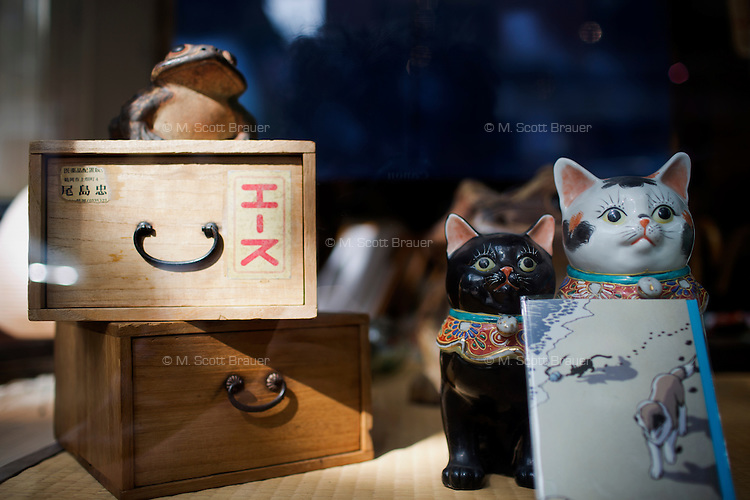 Asian knick-knacks are for sale in the window of Old Japan, Inc, on Union Park Street in the South End of Boston, Massachusetts, USA.