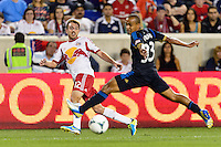 Eric Alexander (12) crosses the ball. The New York Red Bulls and the Philadelphia Union played to a 0-0 tie during a Major League Soccer (MLS) match at Red Bull Arena in Harrison, NJ, on August 17, 2013.