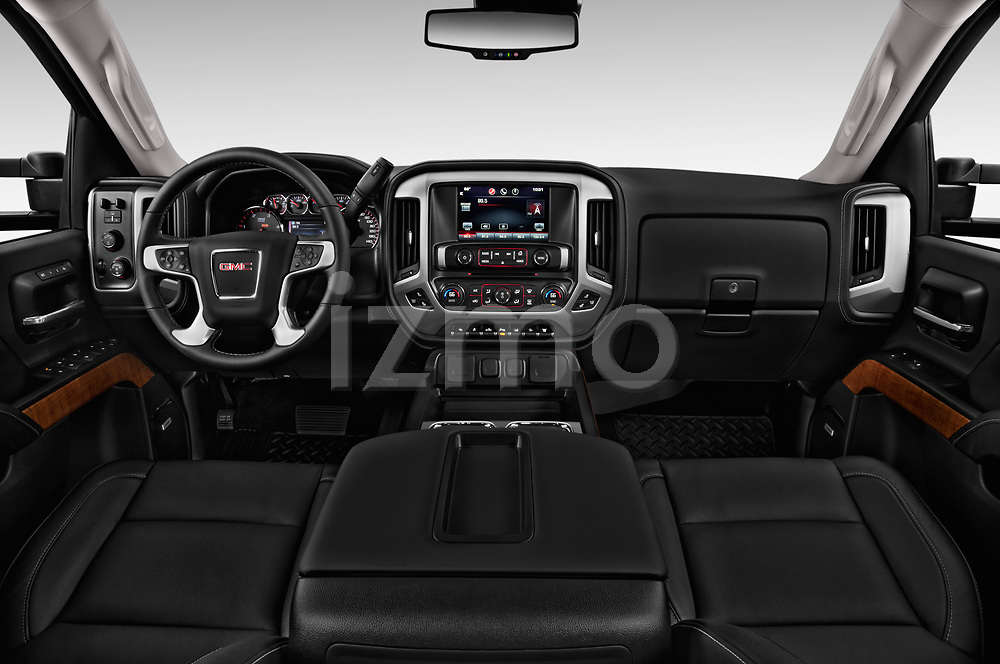 Stock photo of straight dashboard view of a 2019 GMC Sierra 2500HD 2WD Crew Cab Standard Box SLT 4 Door Pick Up