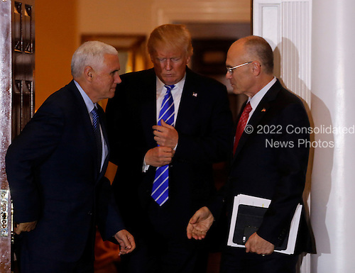 Andrew Puzder (R), chief executive of CKE Restaurants, leaves the clubhouse of Trump International Golf Club, after meeting with United States President-elect Donald Trump (C) and Vice President-elect Mike Pence (L), November 19, 2016 in Bedminster Township, New Jersey. <br /> Credit: Aude Guerrucci / Pool via CNP