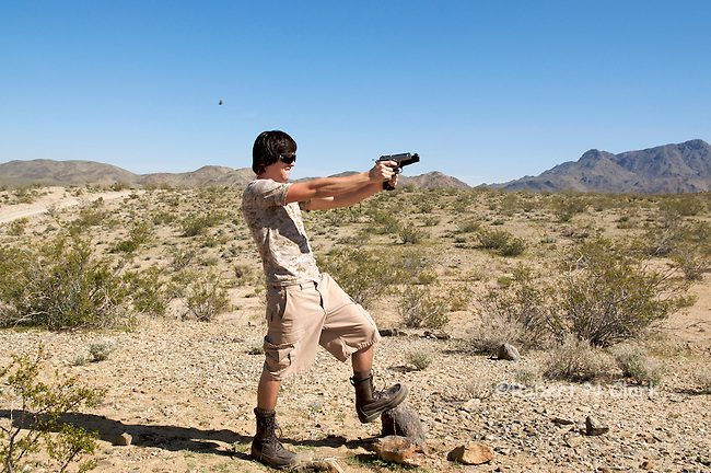 Youth firing Kimber .45 ACP semiauto pistol with .22LR conversion, and Browning .380 semiauto pistol